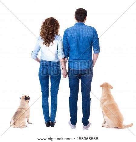 Back View Of Couple With Their Dogs Isolated On White