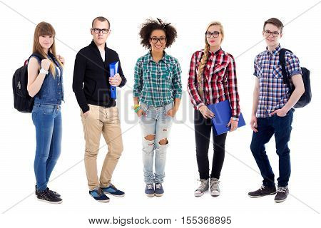 Group Of Teenagers Or Students Standing Isolated On White