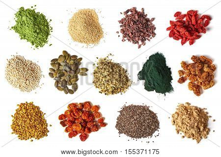 Set of various superfoods isolated on white background