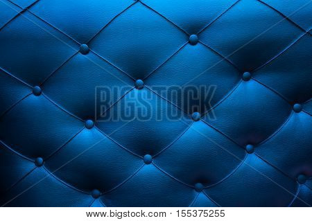classic lounge couch pattern. blue quilted background. pattern triangle texture blue textile