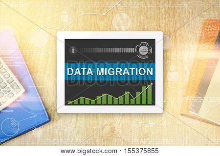 data migration word on tablet with soft light vintage effect