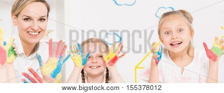 Girls Showing Color Painted Hands