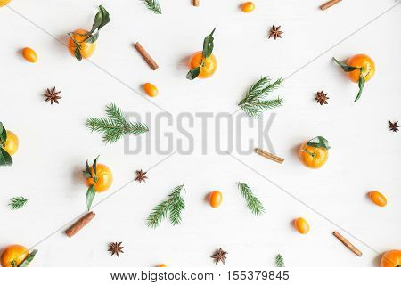 Christmas composition. Christmas frame with tangerines fir branches cinnamon sticks anise star. Flat lay top view