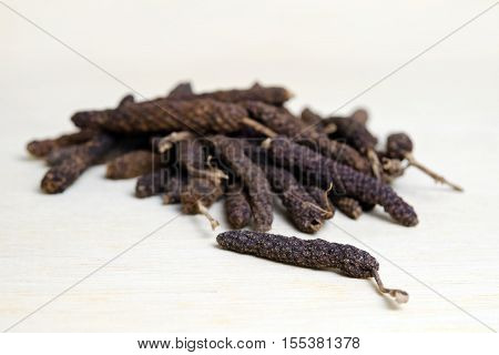 Long Pepper Or Pipli Or Dipli (piper Longum) Isolated On Wood Background