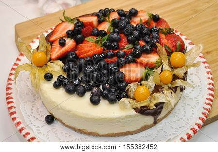 beautiful fresh pound cake with berries coarsely