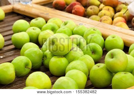 Green Apples On A Counter Of Shop