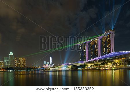 SINGAPORE CITY, SINGAPORE - FEBRUARY 20,2016: Marina Bay Sands at night during Light and Water Show 'Wonder Full' . It opened on 27 April 2010. Singapore on FEBRUARY 20, 2016