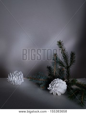 New Year, fir branches and cones on a table in the twilight