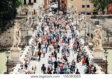 Rome Italy - May 12 2013: Tourist crowds and street vendors on the Ponte Sant'Angelo in Rome.