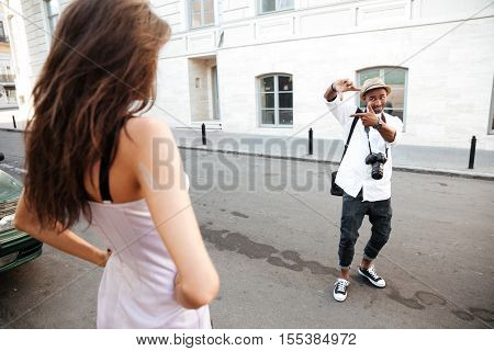 Photo session on the street with afro photographer and with model