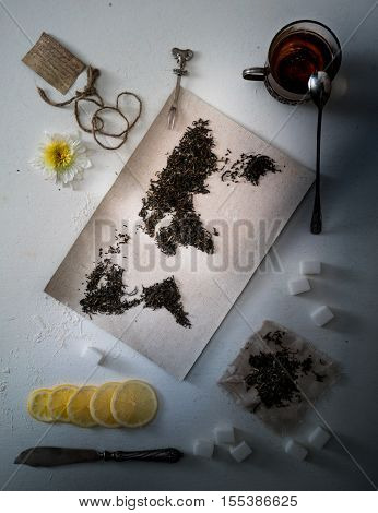 map of the world, lined with tea leaves. Eurasia, America, Australia, Africa. vintage. tea, towel top view flat lay