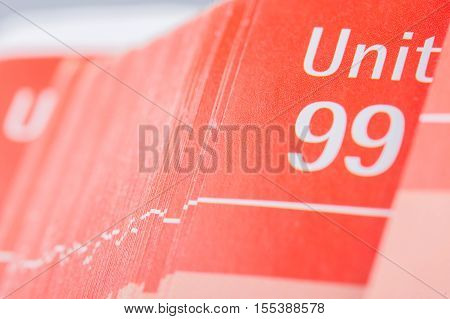 Pages Of Red School Book With Unit Number Ninety Nine