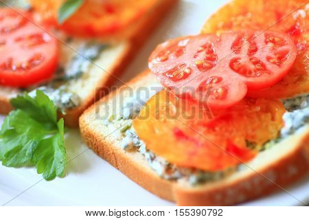Sandwich made of heirloom tomatoes with cilantro mayonnaise on white bread