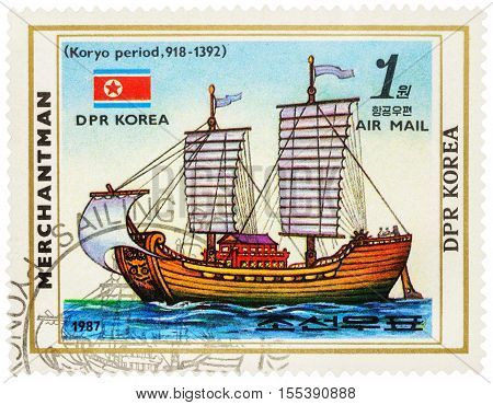 MOSCOW RUSSIA - NOVEMBER 04 2016: A stamp printed in DPRK (North Korea) shows image of Korean sail ship of Koryo period (918-1392) and flag of DPR Korea series