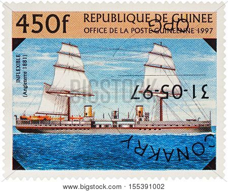 MOSCOW RUSSIA - NOVEMBER 06 2016: A stamp printed in Guinea shows battleship of the Royal Navy Fleet UK