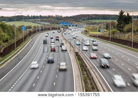 LONDON UK - 07 NOVEMBER 2016: British motorway M25 in a grey cloudy day
