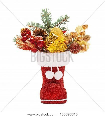 Red boots of Santa Claus with Christmas decorations isolated