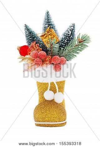 Golden Boots of Santa Claus with Christmas decorations isolated