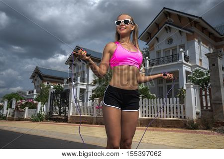 Women jumping with skipping rope