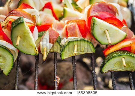 Closeup of skewers with vegetables on the grill