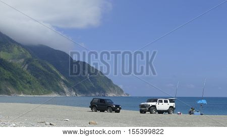 The Man Enjoin Fishing On The Beach With Nice Weather In New Taipei City, Taiwan