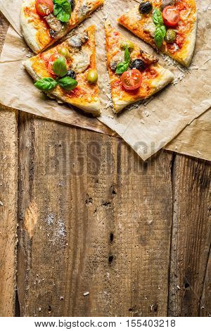 Fresh Pizza On Paper And Old Wooden Table As Background 8