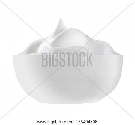 white cup filled with smooth white cream