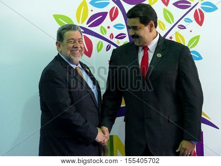 Porlamar Venezuela. September 17th 2016: Saint-Vincent and the Grenadines Prime Minister Ralph Gonsalves greets Venezuelan President Nicolas Maduro at the opening ceremony of the Non-Aligned Movement Summit in Porlamar Venezuela
