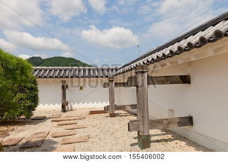 MAIZURU JAPAN - JULY 29 2016: Reconstructed earthen wall (Hei) of Tanabe castle. Castle was erected in 1579 by Hosokawa Fujitaka abandoned in 19th c partly reconstructed in 1940 and 1997