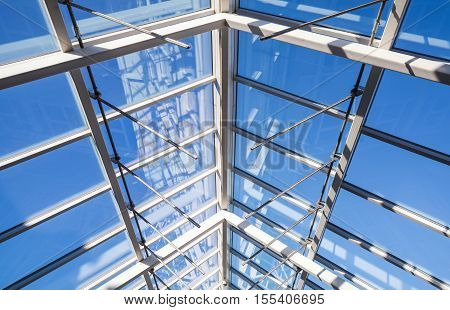 Abstract high-tech architecture background photo internal structure of glass roof arch with lockable windows sections
