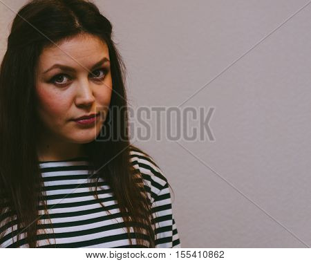 Young pretty brunette girl in stripped frock