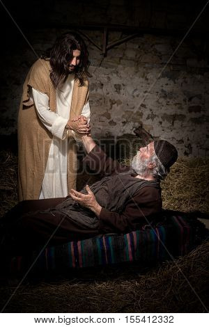 Jesus healing the lame or crippled man