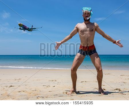 young man flying from passenger plane to natural destination island on blue ocean with happiness face emotion use for people traveling on vacation holiday in summer season.