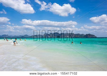 CRABI PROVINCE THAILAND - FEBRUARY 02 2015: Tourists swimming in turquoise water of Andaman sea at Krabi province Thailand