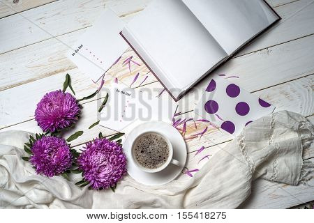 Word relax with book cup of coffee and pink flowers. Copy space for text. greeting card