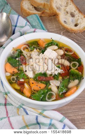 chicken soup with beans spinach tomatoes and other vegetables