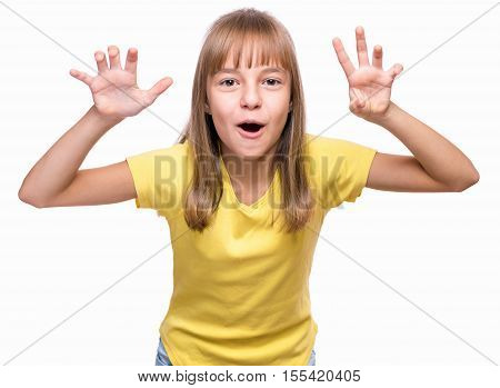 Half-length emotional portrait of caucasian girl wearing yellow t-shirt. Funny cute child looking at camera with her hands in frightening gesture, isolated on white background.