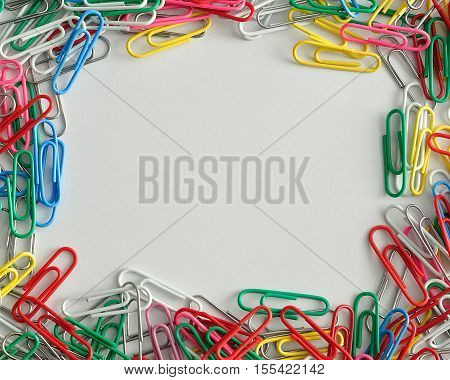 Colorful paper clips border isolated on a white background