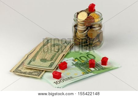 House and coins stack realestate concept isolated on white background