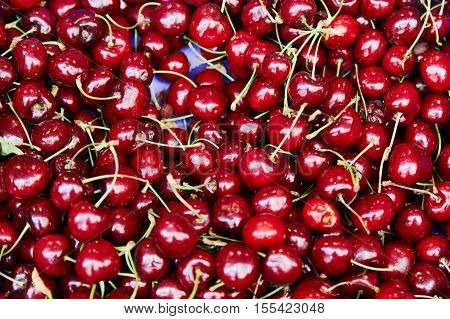 Tasty beautiful sweet cherry on a tray