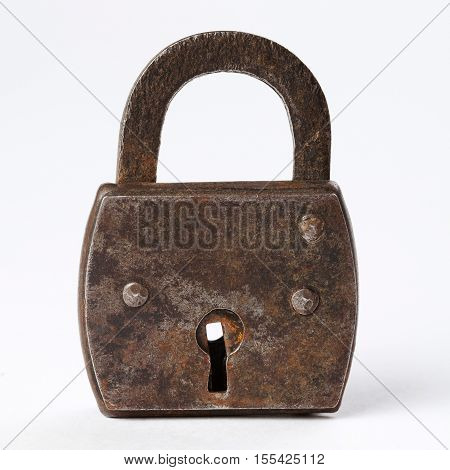 Vintage design rusty padlock locked. metal material, textured, gray color. key hole view. white
