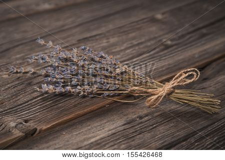 Close-up shot of dried lavender bouquet on grungy wooden background
