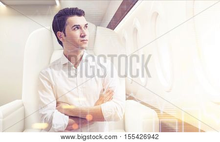 Young Man In Business Class Of A Plane With Graphs