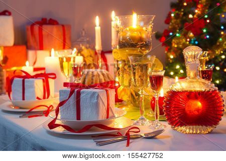 Candlelight And Gifts All Around The Christmas Table