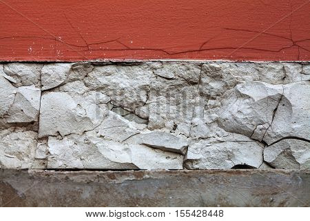 Aged wall. red white paint wall background with cracks craquelure fractures. macro view