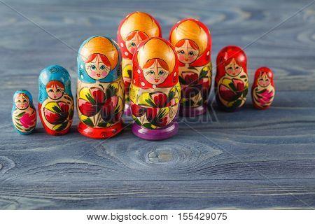 Beautiful Russian Matreshka Doll On Blue Wooden Background