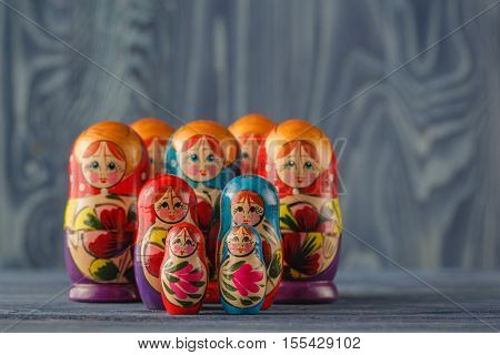 Russian traditional matreshka on blue wooden table