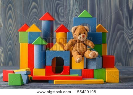 building from wooden colourful childrens blocks with toy