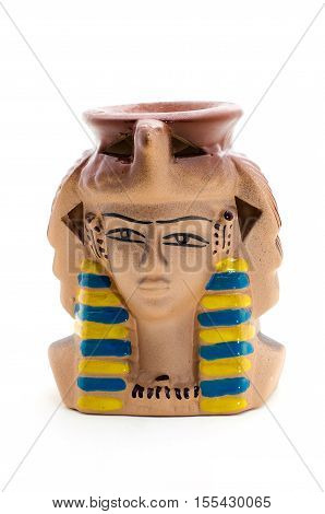 Ceramic statuette of pharaoh Candle Holder on a white background.