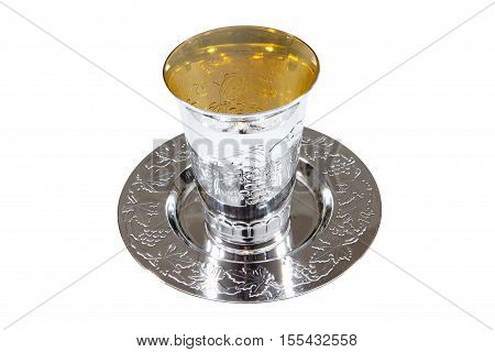 A kiddush cup against a white background